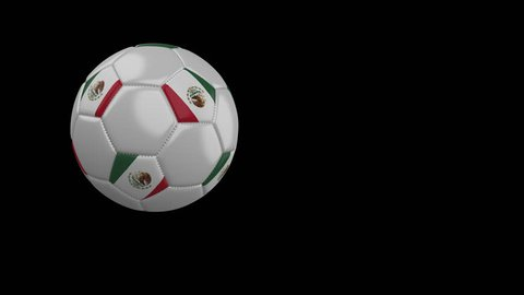 Soccer ball with the flag of Mexico flies past the camera, slow motion, 4k footage with alpha channel