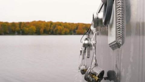 Iron River, Michigan / United States - 10 08 2018: Walleye release restocking an Upper Peninsula, inland lake during the fall colors in Michigan.