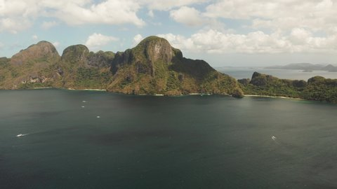 aerial view Seascape with tropical bay, rocky islands, ocean blue water. islands and mountains covered with tropical forest. El nido, Philippines, Palawan. Tropical Mountain Range