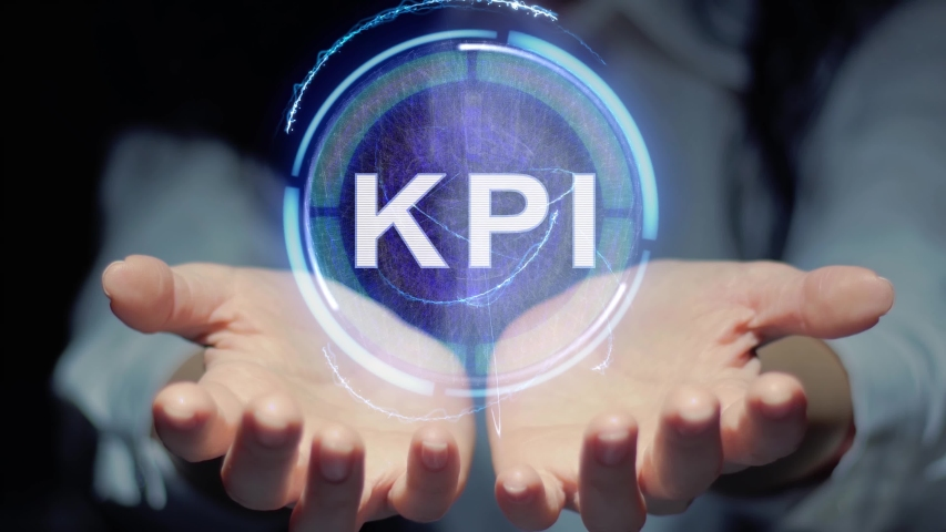 Female hands show a round conceptual hologram with text KPI. Unrecognizable woman in ashen white on a black background with future holographic technology | Shutterstock HD Video #1029583487