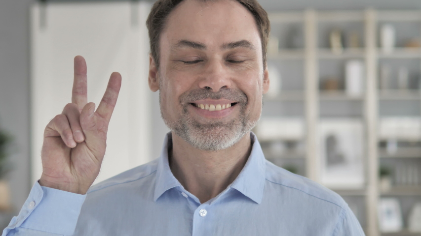 Victory Sign by Senior Aged Businessman | Shutterstock HD Video #1029595967