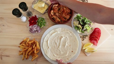 Close up view of a chef making a home chicken Shaworma Pita