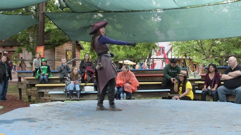 Waxahachie, Texas / USA - 11 May 2019 Scarborough Renaissance Festival Unidentified actors putting on a play about sword combat to an audience.
