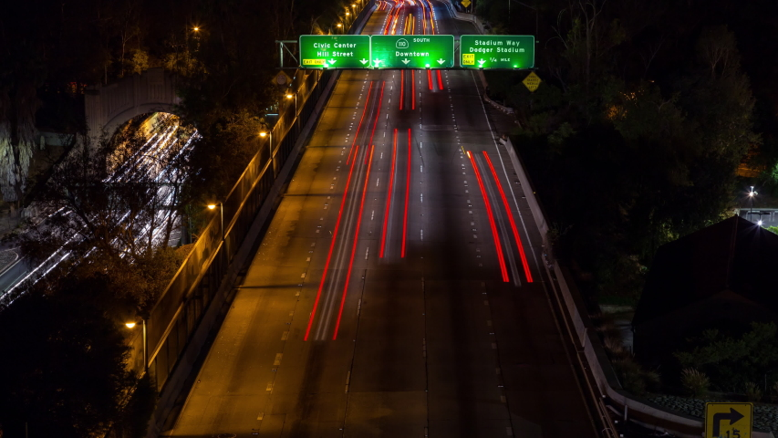 Downtown los angeles and freeway reveal tilt up night timelapse | Shutterstock HD Video #1029721547