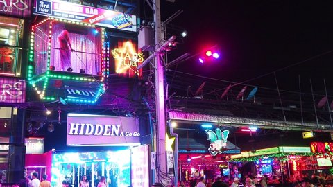 Pattaya, Thailand - March 20, 2019: Famous red light district Walking street in Pattaya with many clubs, bars and prostitutes. The street is a tourist attraction for night life and entertainment.