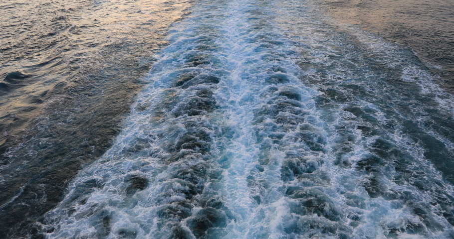 Cruise ship wake Pacific ocean beautiful sunset on water. Destination vacation travel tropical ocean sea. Beautiful blue Caribbean Ocean water wake behind large cruise ship. | Shutterstock HD Video #1029732647