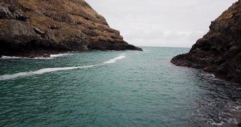 Ocean swells rolling into Flea Bay, New Zealand