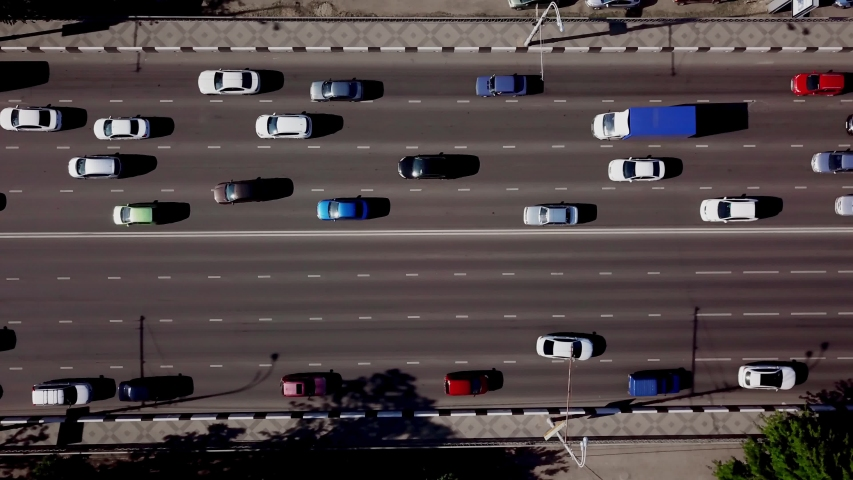 Drone's Eye View - Aerial top down view of urban traffic jam | Shutterstock HD Video #1029734987