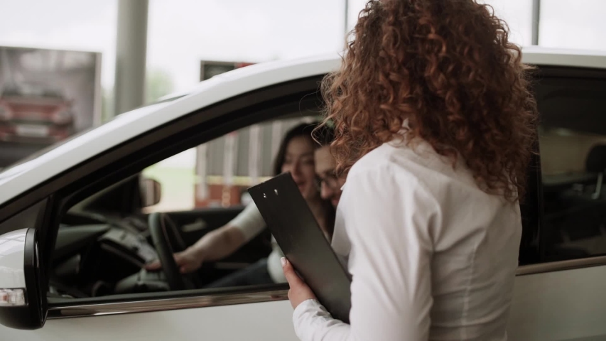 Buying a car at a car dealership   Shutterstock HD Video #1029816707