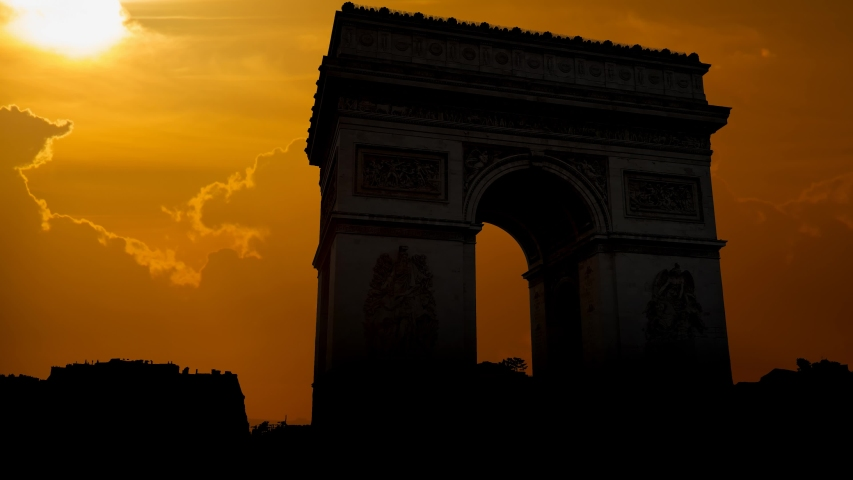 The Arc de Triomphe de l'Etoile or Triumphal Arch of the Star: Time Lapse at Sunset, one of the most famous monuments in Paris, France | Shutterstock HD Video #1029821237
