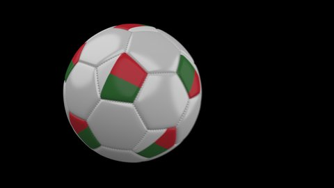 Soccer ball with flag Madagascar flies past camera, slow motion blur, 4k footage with alpha channel