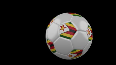 Soccer ball with flag Zimbabwe flies past camera, slow motion blur, 4k footage with alpha channel