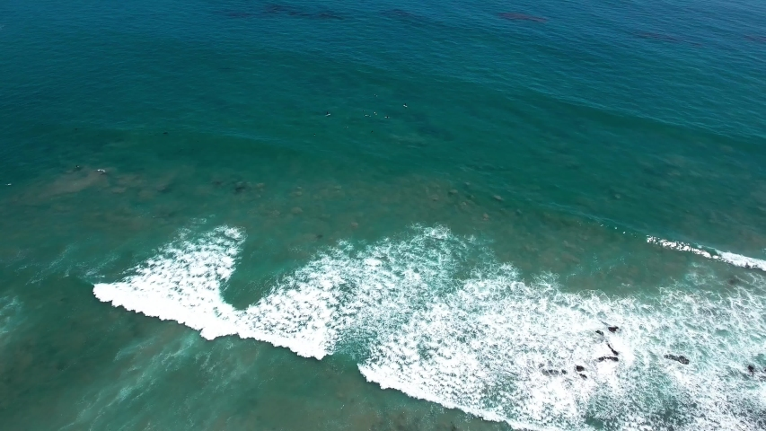 Aerial, drone shot of Malibu beach and Pacific coast highway, overlooking houses, and crashing waves on the coast, in California, USA | Shutterstock HD Video #1029887927