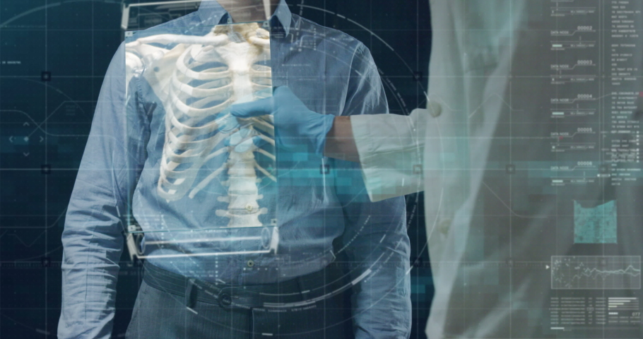 Slow motion of futuristic doctor is examining his patient's skeleton with newest technology scanning with augmented reality holograms in modern laboratory. | Shutterstock HD Video #1029921077