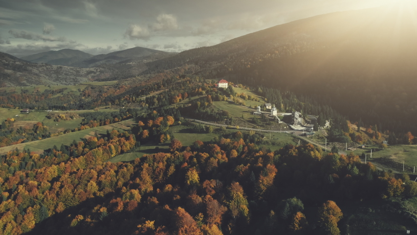 Autumn Forest Mountain Slope Village Aerial View. Panoramic Scenery Hill Meadow Landscape Sight. Wild Nature. Highland Scene of Building Clean Environment. Travel Concept Drone Flight Footage 4K (UHD) | Shutterstock HD Video #1029936617