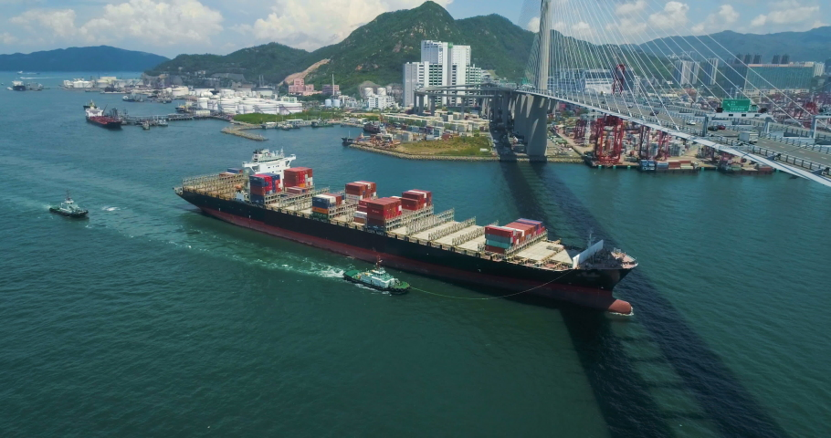 Cargo container ship arriving to Hong Kong Container Terminals. East Asia, Hong Kong, Freight Transportation, Container Ship Aerial drone footage | Shutterstock HD Video #1029987077