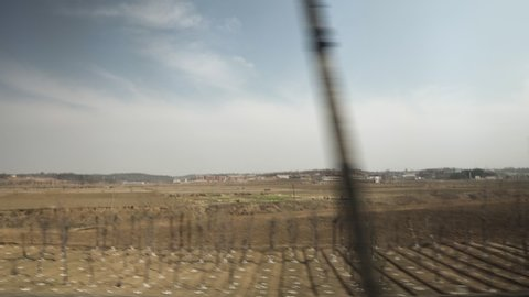 Rare look into North Korean Landscape on a Train Ride (DPRK, Democratic Peoples Republic of Korea)