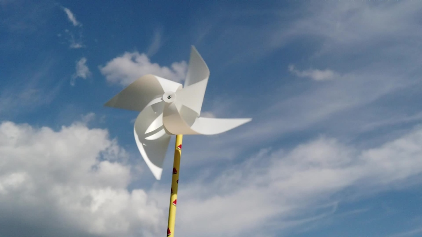 Slow motion, white pinwheel spinning in the wind against blue cloudy sky, summer, freedom concept.   Shutterstock HD Video #1030090637