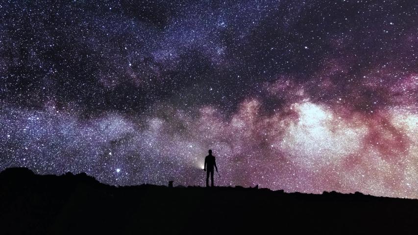 Timelapse night sky 4K - Man looking Milky Way | Shutterstock HD Video #1030126517