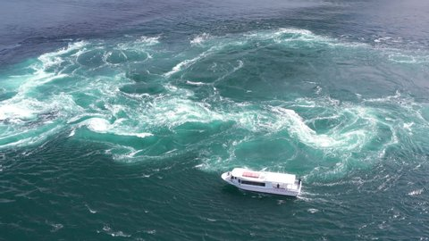Japan, whirlpools under Naruto Bridge, aerial view by drone