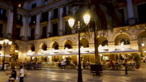 BARCELONA, SPAIN - AUGUST 21, 2018:  Evening view of Placa Reial with restaurants in summer. Barcelona, Spain