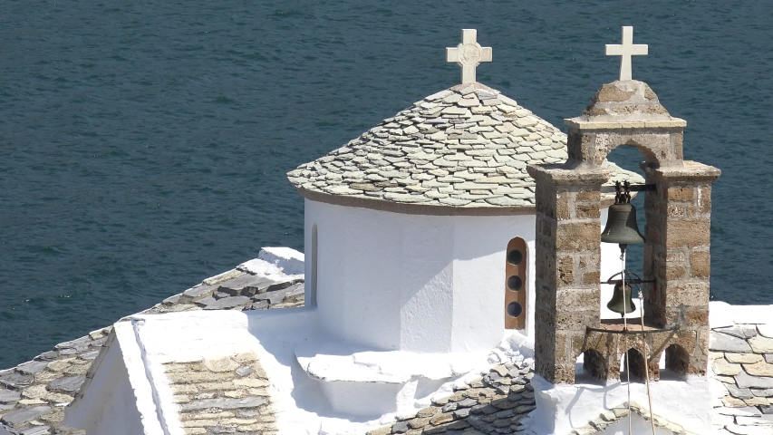 4K Amazing Skopelos monastery building rooftop, iconic view church bells by day