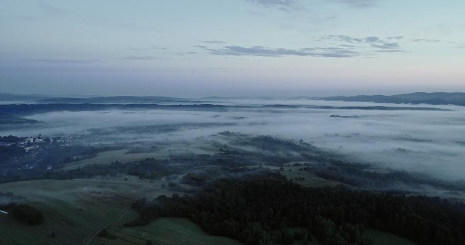 Drone footage of the beautiful foggy landscape. | Shutterstock HD Video #1030240247