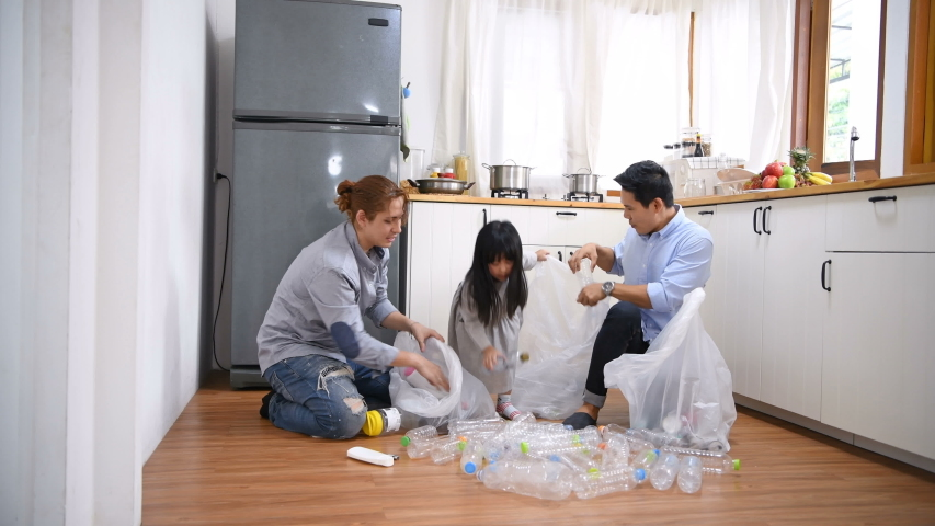 Family concept. The brothers are helping to sort the garbage in the kitchen.