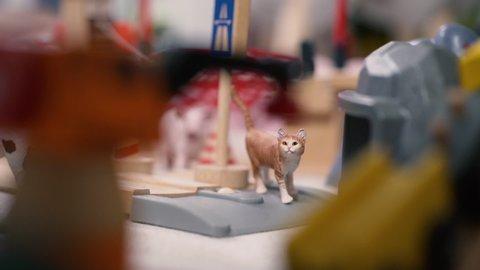 Plastic miniature cat with toys around