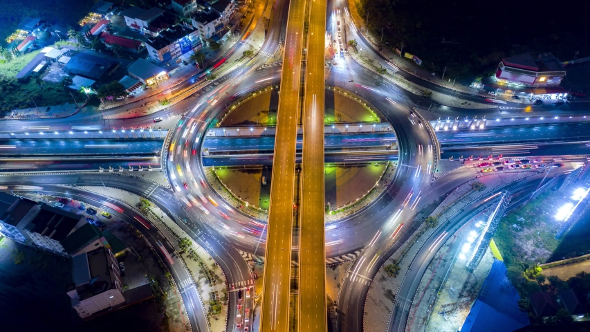 4K Aerial view Time lapse of the circular intersection expressway, highway in the traffic for transportation over intersection bridges and ring road   Shutterstock HD Video #1030471307