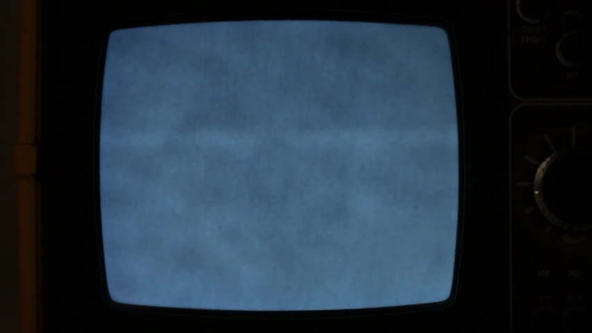 The black and white TV screen flashes in the dark. | Shutterstock HD Video #1030518347