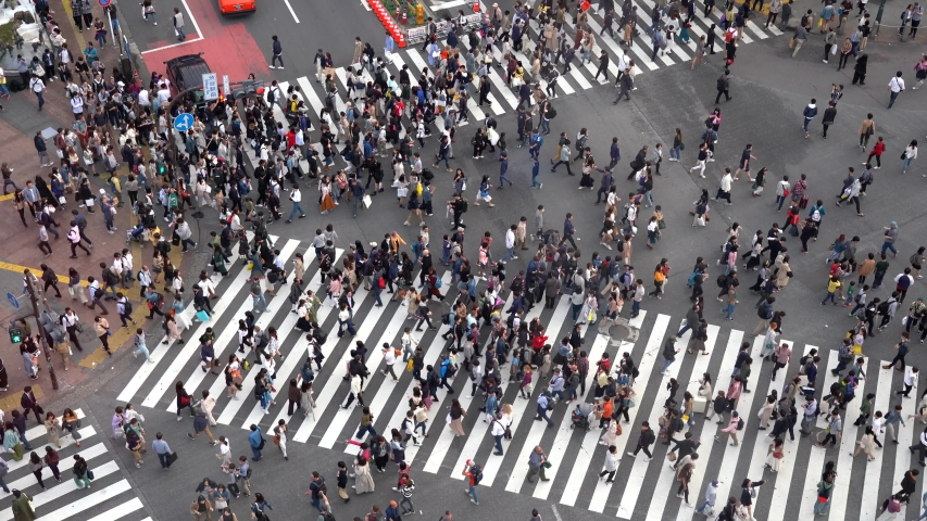 Shibuya Crossing 4K UHD high angle view, one of the busiest crosswalks in the world. Pedestrians crosswalk at Shibuya district. Tokyo, Japan - May 3, 2019 | Shutterstock HD Video #1030539617