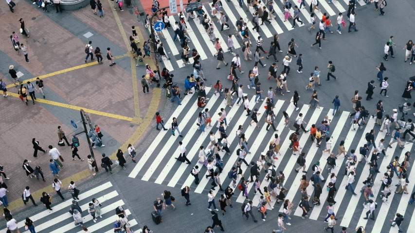 June 2, 2019: Shibuya, Tokyo, Japan - Aerial view of pedestrians walk at Shibuya Crossing. The scramble crosswalk is one of the largest in the world.