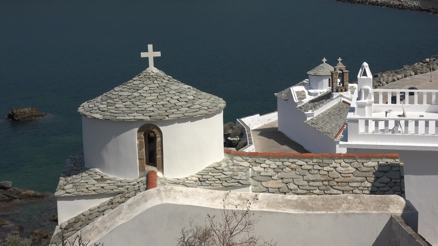 4K Aerial view of famous Skopelos church by day, popular sightseeing building emblem