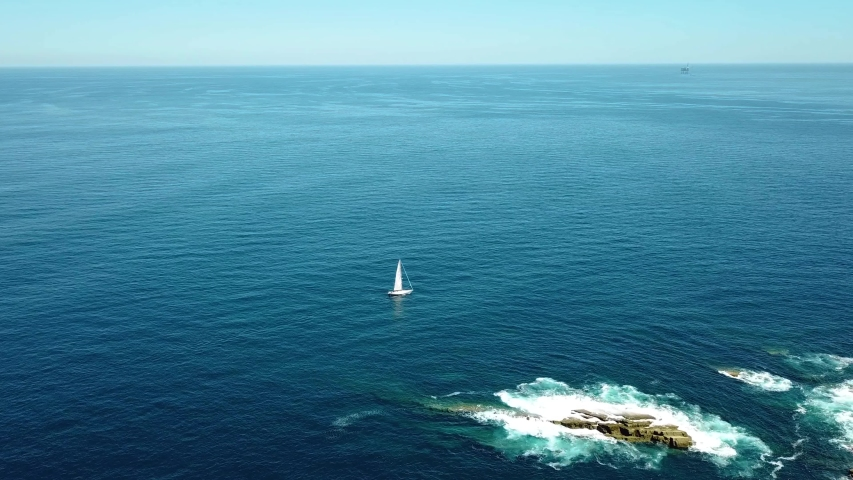 Sailboat on the Spanish coast 4K drone aerial footage | Shutterstock HD Video #1030676447