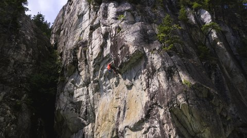 Aerial drone of Caucasian American adventure male climber climbing outdoors in Squamish Valley British Columbia