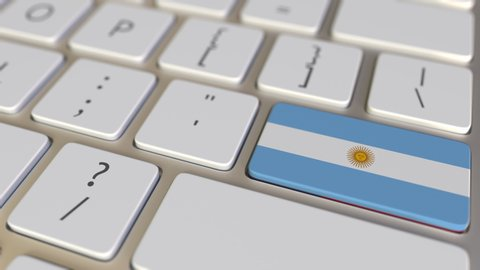 Key with flag of Argentina on the computer keyboard switches to key with flag of the USA, translation or relocation related animation