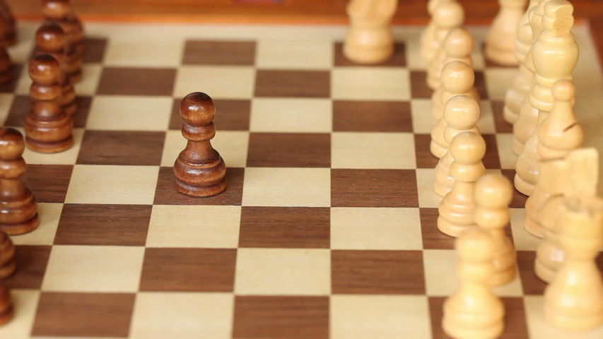Child and adult play chess. Childrens hand moves chess pieces | Shutterstock HD Video #1030879757