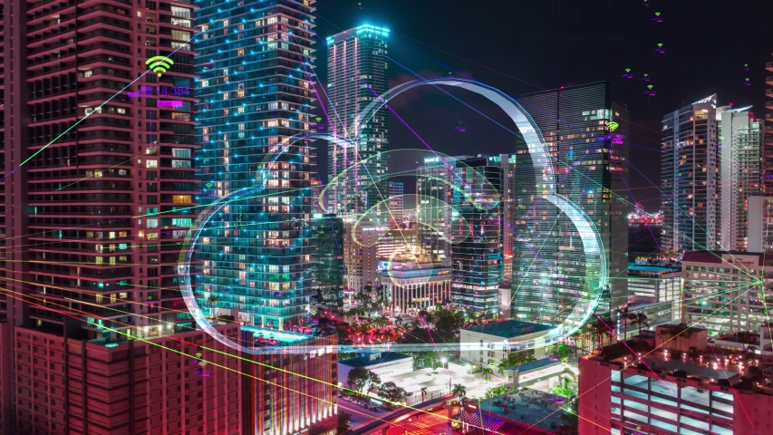 Futuristic city technology concept with Wireless network 5G icons, Futuristic Night City Hyperlapse data communication, big data using artificial intelligence. Aerial smart city. Financial District  | Shutterstock HD Video #1030891667