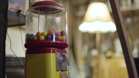 Old vintage gumball machine in a dimly lit garage