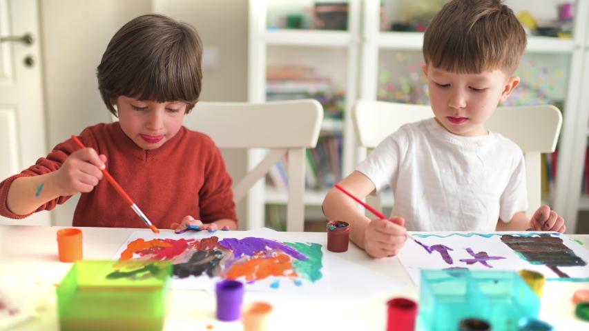 Cute kids doing their craft, painting at kindergarten | Shutterstock HD Video #1030962377
