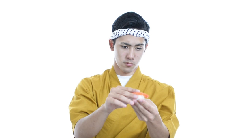Smiling Japanese chef in uniform.   Shutterstock HD Video #1031060687