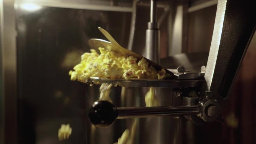 Popcorn Popping in Machine . | Shutterstock HD Video #1031061047