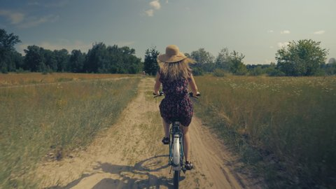 Woman In Hat.Woman On Bicycle.Girl Riding On Bicycle.Woman Bike Riding.Happy Beautiful Girl With Bike.Lady Moving On Bicycle.Attractive Lady Cycling.Woman With Blonde Hair Cycling.Beautiful Girl Hat.