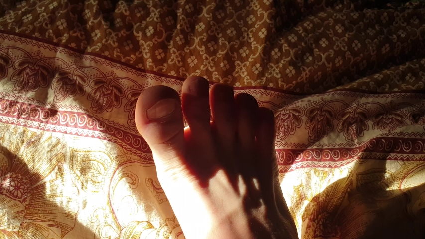 Feet on the bed. Bare feet on the blanket. | Shutterstock HD Video #1031130677