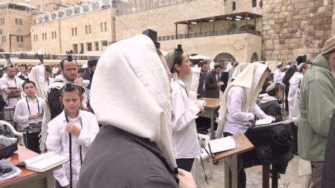 Jerusalem, Israel- May 24, 2019 jewish orthodox man pray, crowd of prayers western wall temple  singing man pray