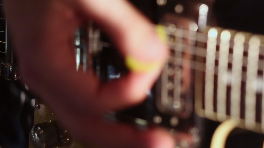 Close up of hands playing electric guitar in live action on stage at a concert | Shutterstock HD Video #1031425937