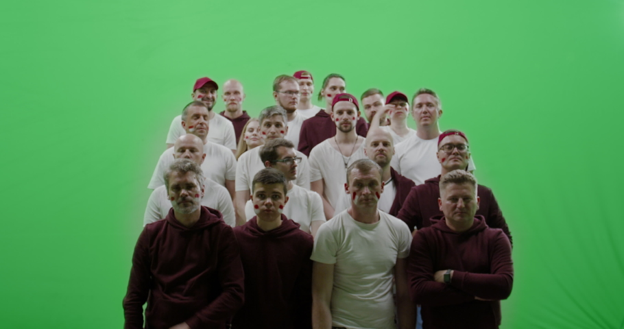 GREEN SCREEN CHROMA KEY Front view group of people fans wearing red clothes watching a sport event. 4K UHD ProRes 422 HQ | Shutterstock HD Video #1031443637