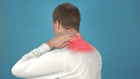 Pain in the neck muscles and shoulders due to long-term work at the  computer  myositis  concept of kyphosis or osteochondrosis  man in white  shirt suffers from rachiocampsis  office worker or manager