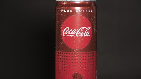 Thessaloniki, Greece - June 15 2019: Coca Cola Plus Coffee rotating can. 330 ml turning can with water droplets on black background of new soft sugarless drink with more caffeine than a Coke Classic.